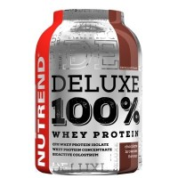 Nutrend Deluxe 100% Whey Protein 900g vanilkový puding